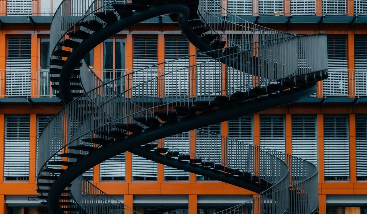 black-metal-spiral-staircase-in-building-3847484